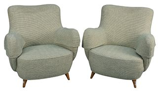 Pair of Vladimir Kagan Barrel Chairs, with light green upholstery and walnut legs, height 30 inches, width 30 inches, depth 27 inches. Provenance: The