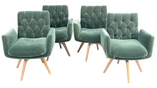 Set of Four Vladimir Kagan Swivel Armchairs, upholstered in green mohair, having button tufted backs, solid walnut legs, seat height 12 inches, height