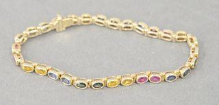 14 Karat Ladies Bracelet, having colored stones. 11 grams.