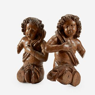 Two Continental Carved Walnut or Limewood Putti, 17th century