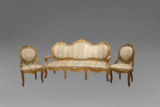 Eight armchairs and a three-seater sofa in carved and gilded wood, with plant motifs and scrolls, 19th century