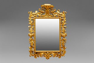 Large mirror in richly carved and gilded wood, 19th century