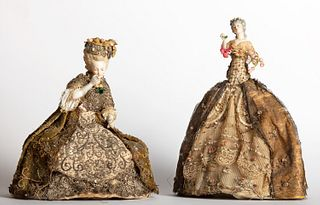 Two dolls with embroidered fabric dresses and porcelain bodies, 19th century
