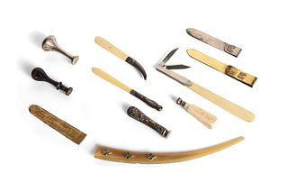 Lot consisting of four seals and seven letter openers of different materials, some in silver