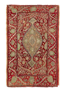Three ancient fabrics embroidered with silk and silver threads on a red velvet background, Middle East
