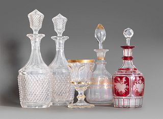 Four bottles and a crystal goblet, 20th century