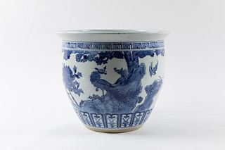 Large blue and white porcelain cachepot decorated with landscape and birds, China, 20th century