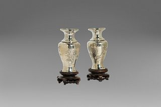 Two small silver vases with floral decorations, China, 20th century