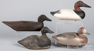 Four carved and painted duck decoys