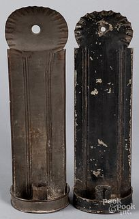 Two tin candle sconces, 19th c.