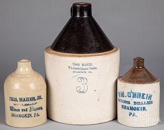 Three Pennsylvania stoneware advertising jugs