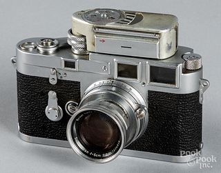 Leica M3 camera with light meter and lens.
