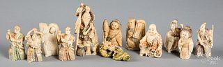 Twelve Japanese carved bone netsuke.