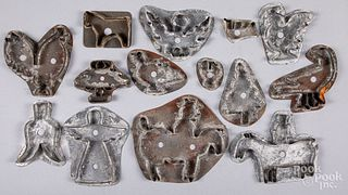 Collection of antique tin cookie cutters.