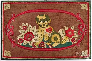 Dog and floral hooked rug, early 20th c.