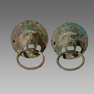 A pair of ancient Roman Bronze Lion Head Handles c.2nd century AD.
