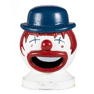 A Painted Cast Iron Clown Trash Can Topper