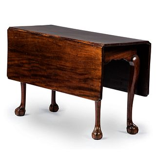 A Chippendale Figured Mahogany Ball-and-Claw Foot Drop Leaf Dining Table