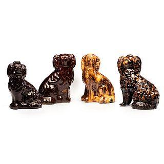 Four Rockingham and Albany Glaze Spaniel Figures