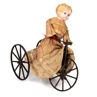 A Cast Iron and Composition Girl on Velocipede Toy