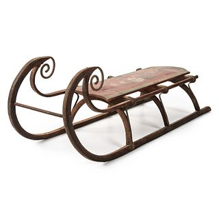 A Carved and Painted Wooden Sled