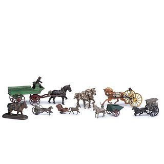 Eight Cast Iron and Pressed Tin Horse Drawn Toys