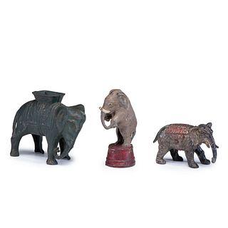Two Cast Iron Elephant Still Banks and a Campaign Souvenir