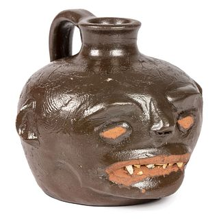 A Guy Daugherty Brown-Glaze Stoneware Face Jug, Bethune, South Carolina, Circa 1950
