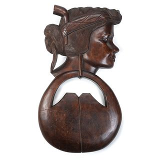 A Figural Walnut Wall Plaque