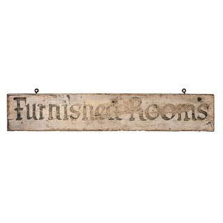 A Wooden Sign in Old Paint Advertising Furnished Rooms
