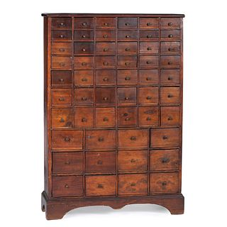 A Country Stained Pine and Cherrywood 54-Drawer Apothecary Chest