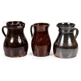 Three Albany Glazed Stoneware Pitchers