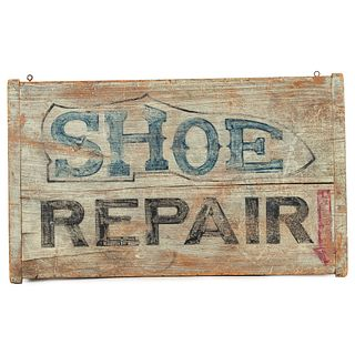 A Wooden Shoe Repair Sign in Old Paint
