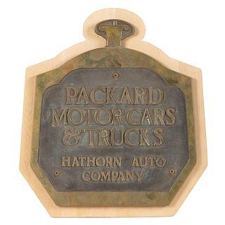 A Brass Packard Motor Cars and Trucks Plaque