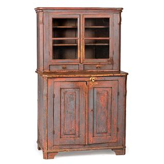 A Continental Blue and Red Painted Pine Step-Back Cupboard