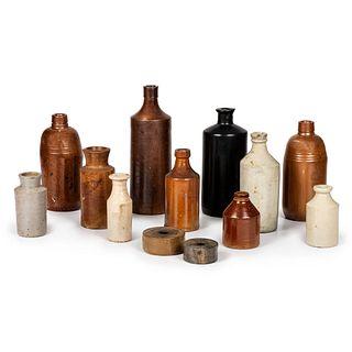 Thirteen Stoneware Inkwells and Bottles