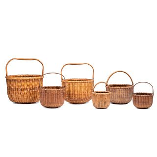 Six Nesting Woven Nantucket Baskets with Swing Handles