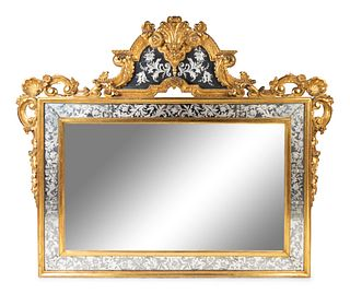 A Venetian Rococo Style Giltwood and Etched Glass Mirror Height 59 x length 75 inches.