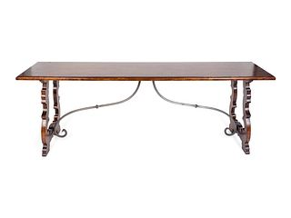 An Italian Baroque Style Mahogany Trestle Table Height 30 x width 84 x depth 22 1/2 inches.