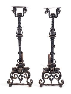 A Pair of Renaissance Style Wrought-Iron Andirons Height 41 x width 13 x depth 36 inches.