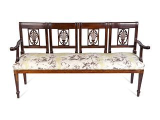An Italian Neoclassical Carved Mahogany Quadruple Chairback Settee Height 36 x length 67 x depth 16 inches.