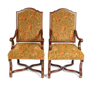 A Pair of Regence Style Walnut Armchairs Height 44 x width 24 x depth 20 inches.