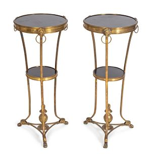 A Pair of Neoclassical Style Gilt-Bronze and Black Granite Gueridons Height 28 1/4 x diameter 12 1/4 inches.