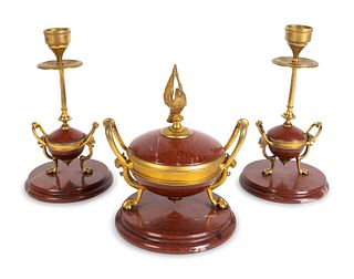 A Napoleon III Gilt Bronze and Rouge Marble Three-Piece Desk Set Height of urn, 6 1/2, candlestics, 7 1/2 inches.