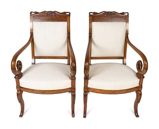 A Pair of Louis Philippe Style Burl Walnut Swan-Crested Fauteuils Height 39 x width 23 x depth 18 1/2 inches.