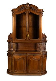 A Victorian Style Carved Walnut Buffet à Deux Corps Height 125 x width 80 x depth 24 1/4 inches.