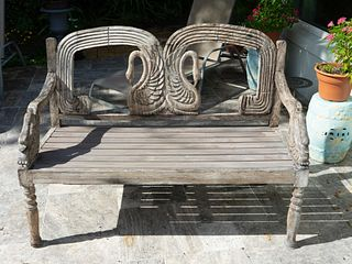 A Pair of Swedish Weathered Teak Garden Benches Height 38 1/2 x width 51 3/4 x depth 22 inches.