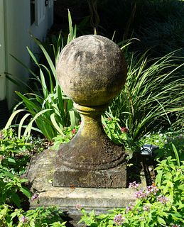 A Pair of Carved Stone Sphere Form Capitals on Pyramid Bases Height 36 x width 36 inches.