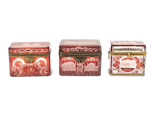 Three Bohemian Cranberry-Flashed Glass Boxes First: 4 3/4 x 3 x 1 1/4 inches; second: 3 x 3 3/4 x 2 1/4 inches; third: 3 1/4 x 4 x 2 7/8 inches.