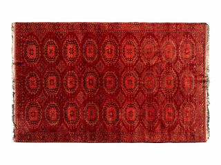 A Bokhara Wool Rug 9 feet 4 inches x 5 feet 11 inches.